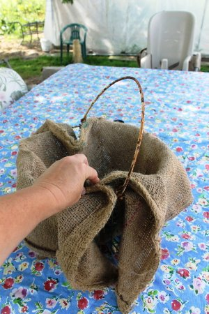 Center burlap and bring it up around the basket