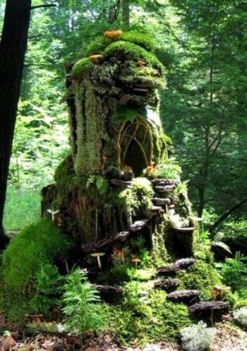 Shirley Boley shares this fantastical tree stump with a arched fairy door.