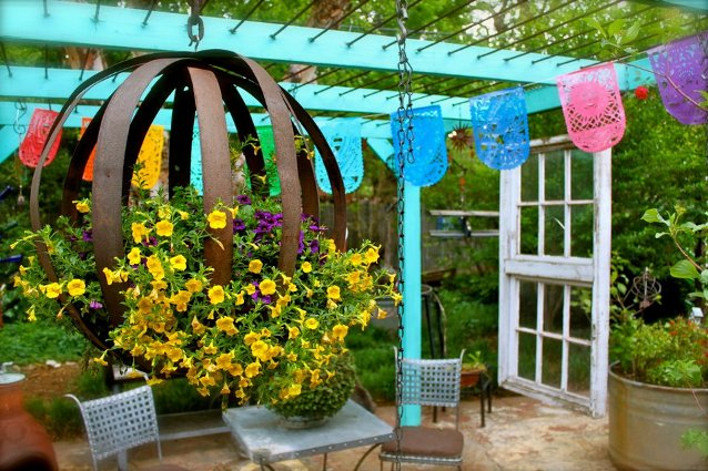 Barb Brashier's barrel hoop sphere is filled with Million Bells and contrasts nicely with bright teal.