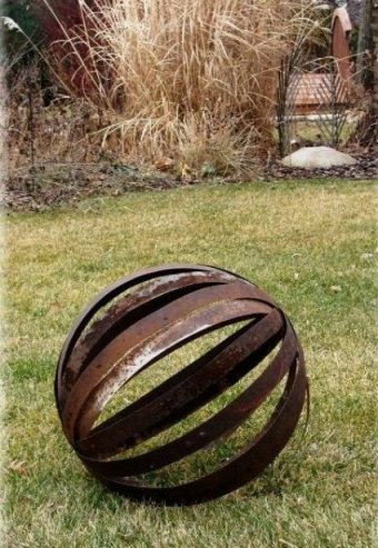 Jeanne Sammons's whiskey barrel bands 'Sphere' ...ready for the grandkids to roll around in the pines!