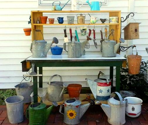 """Nancy Carter says, """"My favorite project for this year was my potting bench. We bought a porcelain topped table at half price at the end of an estate sale and added the shelves and hardware cloth."""""""