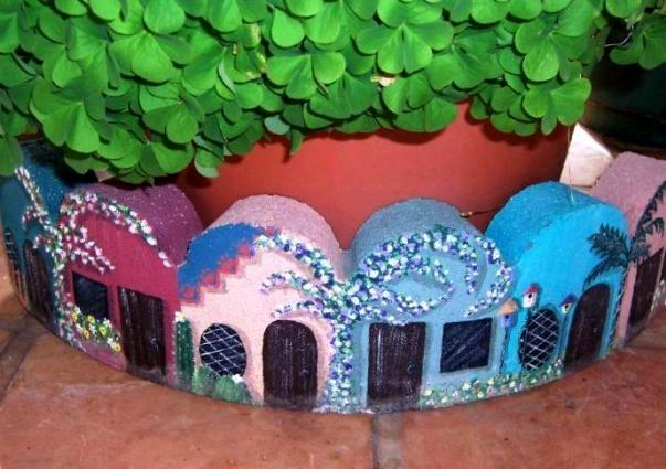"Becky Capps says, ""I took a concrete tree ring and made it into a village...it was more fun than I can even tell you!"""
