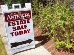 Antique store sponsered estate sale sign