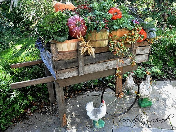 An Autumn decorated flower cart posted for us by Serendipity Refined, perfect for displaying flowers  in the garden.