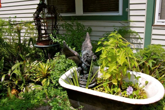 Tanya, from Blondeponders Garden and Duck tales found this tub on a community garden tour.  A gargoyle takes a refreshing bath!