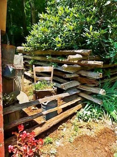 A split rail fence surrounds this middle area between the Rhodie and the 'new' shed