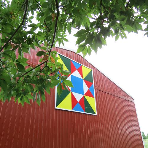 """This huge  8'x8'  """"quilt"""" was made from 3 sections of aluminum, and then painted and hung by its creator, Diana's son Mark, and another son Jeff, along with 3 grandsons."""