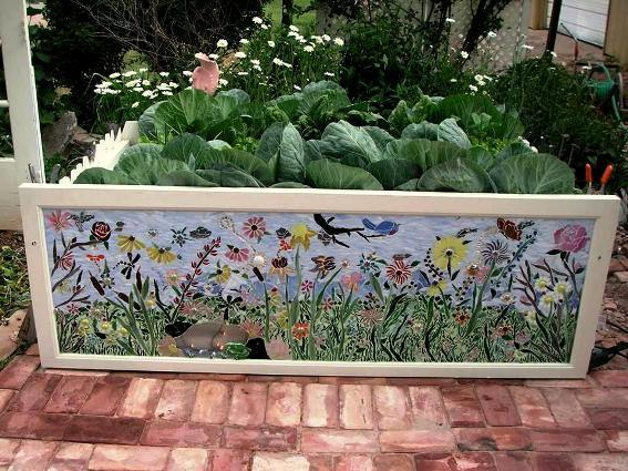 Becky dreamed up a field of flowers, grasses, insects and birds to echo the real foliage beyond