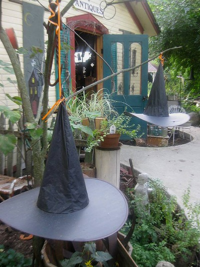 Hang witches hats from branches and trees