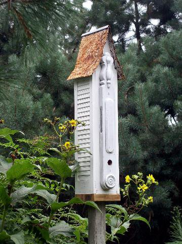 Jeanne Sammons's shutter bird home with a rusty roof