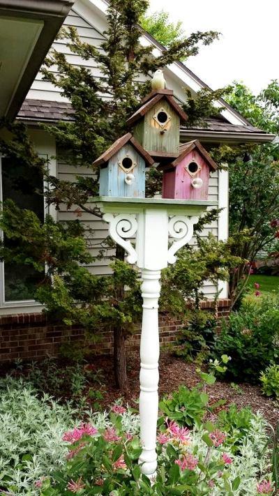 Sandra Hogan painted these birdhouses, each a different pastel color