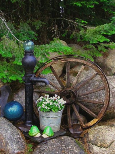 Kirk Willis rustic vignette makes use of some natural rock at the back of his garden