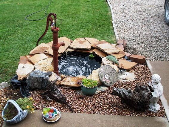 Joan Adolf's pump, set next to her pond, made from an old tire!