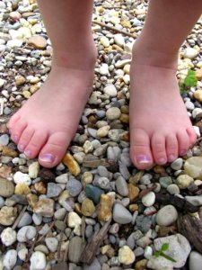 Nancy Anne's grandchild spends barefoot days...