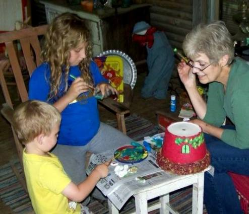 Painting pots for the fairies' gardens..... and finishing the fairy queen's house...