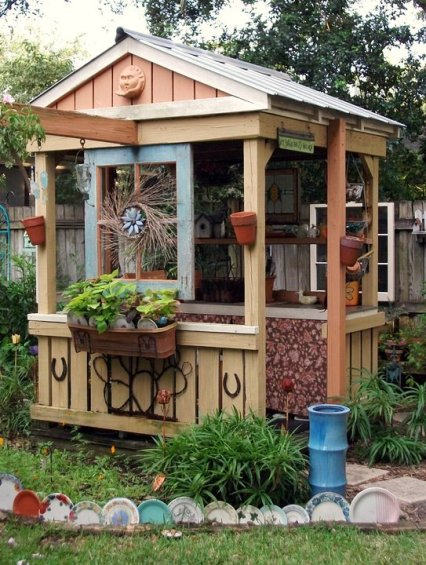"""This imaginative potting shed proves that Mary Mirabal has loads of garden style. She's says, """"I hung this """"found"""" window frame on my potting shed. The potting shed actually began its life as my children's play and swing set. We re-purposed it into my potting shed after the kids were grown."""""""