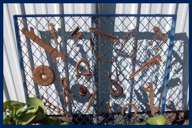 Nancy K. Meyer's heavy wire gate not only is her favorite color, but displays all her rusty tools