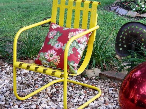 Debbie McMurry added a bright pillow after painting her chair a vibrant yellow