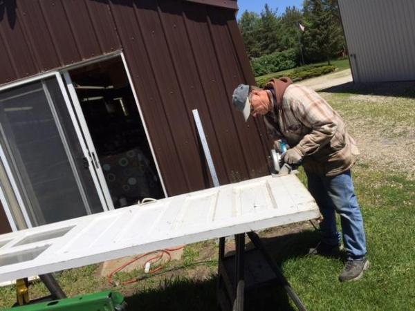 Larry trims the tall doors