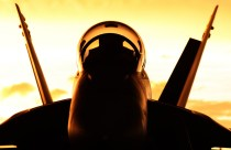 A No. 6 Squadron F/A-18F Super Hornet at sunrise during Exercise FARU SUMU, RAAF Base Darwin