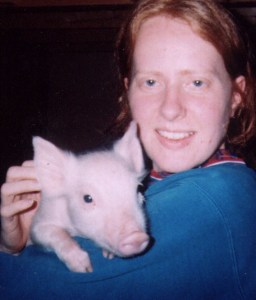 Julie with a piglet