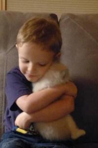 Stephen, my 3.5 yr old grandson, hugging Ocean