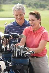 Couple playing golf.