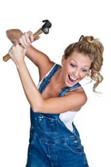 1408985868-happy-woman-swinging-hammer