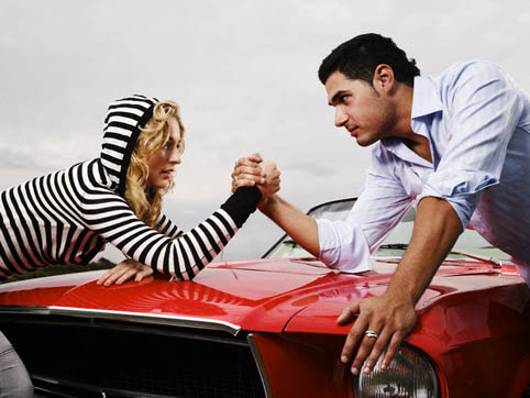 Couple Arm Wrestling on Car Hood