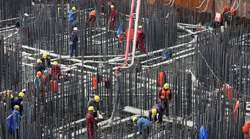 NANTONG, CHINA - NOVEMBER 08: Construction workers cast concrerte on the bearing platform of main piers of Hutong Yangtze River Bridge on November 8, 2017 in Nantong, Jiangsu Province of China. The 11,072-meter-long Hutong Yangtze River Bridge started construction in March 2014, spanning 1,092 meters on the south side and 336 meters on the north. As the world's longest cable-stayed bridge, it has a design that allows dual-use, with rails on the lower layer and a highway on the top. It will only take about one hour traveling from Shanghai to Nantong after its completion. (Photo by VCG/VCG via Getty Images)