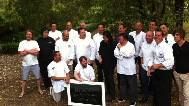 A chef group picture. Rene Redzepi is holding the sign.
