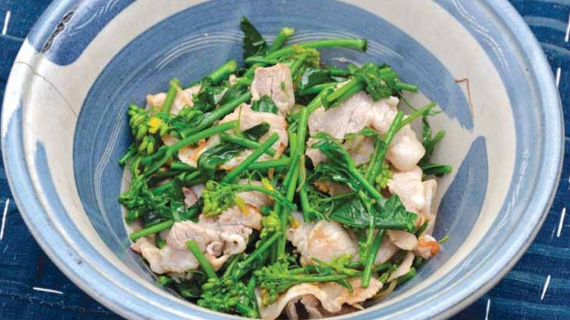 Pork and flowering mustard stir-fry is one of the dishes featured in the cookbook.