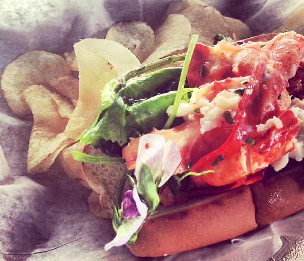 What could possibly make a lobster roll tastier? Butter: lots of it, and a nice cool pinot grigio.