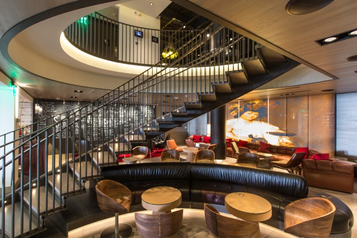 The renovated lobby of Kimpton's Hotel Vintage in Portland features the new Bacchus Bar and a spiral staircase leading up to the fully-stocked game room. (Photo credit: John Valls)