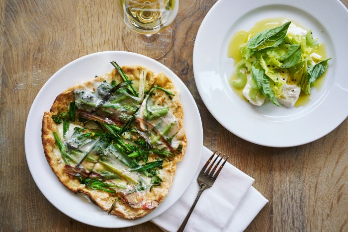 Pizzetta with wild onions, Fontina and arugula & Mozzarella di bufala with celery and olio verde (Please credit Marcus Nilsson)