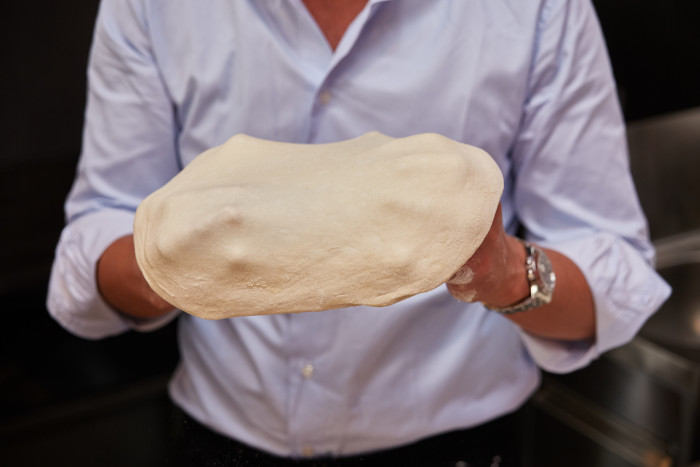 The dough is stretched after it reaches room temperature.