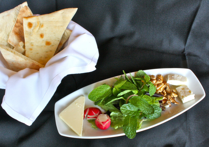 Every meal at Pomegranate On Main begins with a complimentary starter of feta cheese, nuts radishes, and fresh herbs. (Photo credit: Pomegranate On Main)