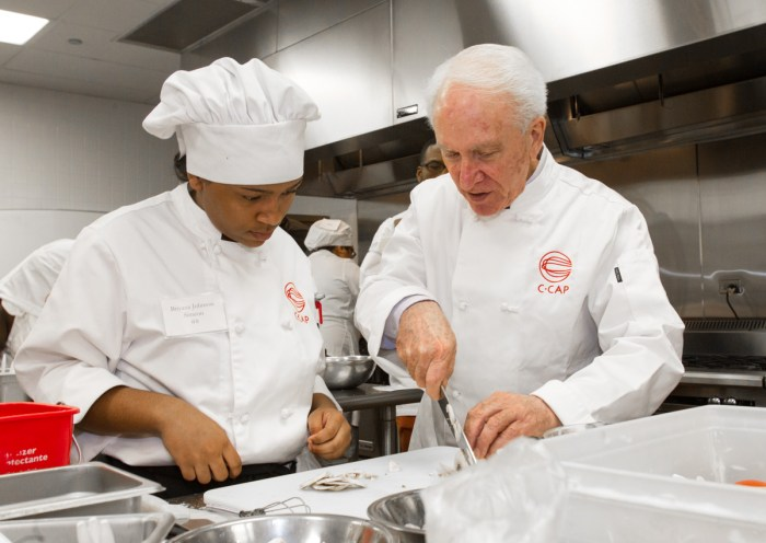 Richard Grausman (right) runs the Careers Through Culinary Arts Program, teaching many high school students about the restaurant industry.