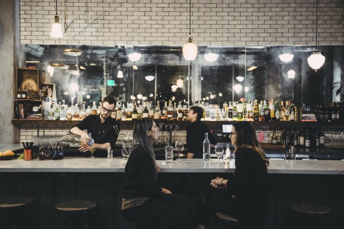 The bar at Rue is perfect for lingering over a well-crafted cocktail and one (or more) of Chef Jason Roberts's vegetable-forward small plates. (Photo credit: Rue)