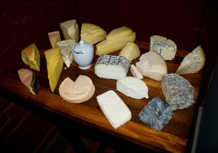 If you're a cheese fan, you'll flip for the in-house Maître Fromager, a trained expert who curates an ever-rotating collection of cheeses. (Photo credit: L'Albatros Brasserie & Bar)