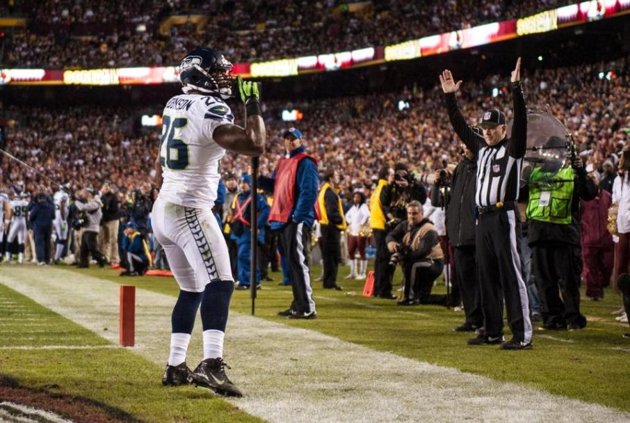 Head linesman Derick Bowers signals a touchdown by Seahawks fullback Michael Robinson. (Seattle Seahawks photo)