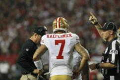 Line judge Tom Stephan indicates a timeout is ending to 49ers quarterback Colin Kaepernick and coach Jim Harbaugh. (San Francisco 49ers photo)
