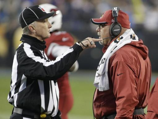 Head linesman Steve Stelljes makes a point to Bruce Arians (Arizona Cardinals photo).