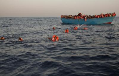 Migrants, most of them from Eritrea, jump into the water from a crowded wooden boat as they are helped by members of an NGO during a rescue operation on the Mediterranean sea, about 13 miles north of Sabratha, Libya, Monday, Aug. 29, 2016. Thousands of migrants and refugees were rescued Monday morning from more than 20 boats by members of Proactiva Open Arms NGO before transferring them to the Italian cost guards and others NGO vessels operating at the zone. (ANSA/AP Photo/Emilio Morenatti)