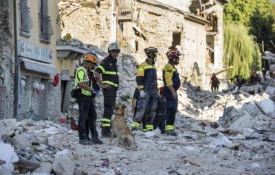 Rescue workers dig through the rubble in the earthquake-stricken Lazio town of Amatrice, central Italy, five days after the devastating quake, 29 August 2016.  ANSA/MASSIMO PERCOSSI