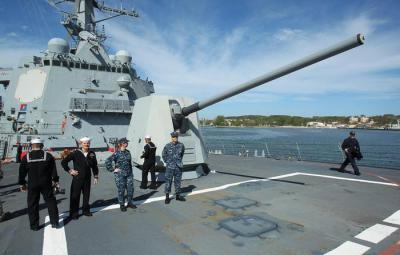epa04735044 Navy soldier stand on deck of the U.S. Navy's Arleigh Burke-class destroyer 'USS Jason Dunham' (DDG-109) as it enters the military port in Gdynia, Poland, 06 May 2015. The US warship, on which more than 300 soldiers are deployed, is on a two-day visit to the Polish harbor city. The vessel earlier had taken part in the North Atlantic Treaty Organization's (NATO) naval exercise in the Baltic Sea.  EPA/PIOTR WITTMAN POLAND OUT