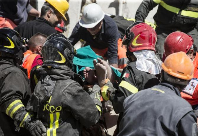 A man pulled from the rubble of collapsed house after the earthquake in Fonte del Campo near Accumoli, central Italy, 24 August 2016.  ANSA/ANGELO CARCONI