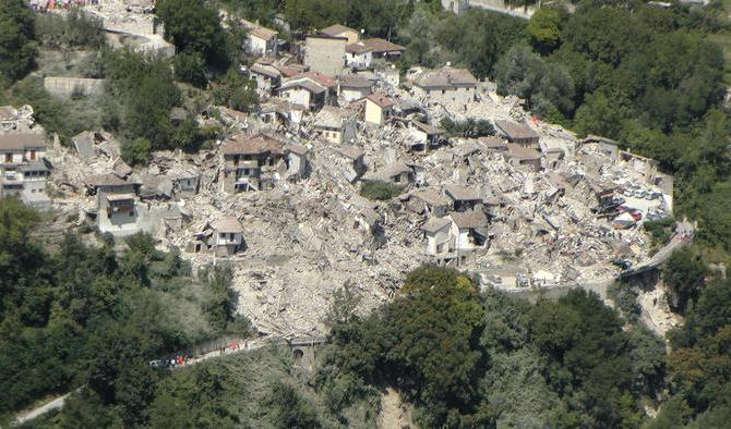 An aereal view of collapsed and damaged houses due to earthquake in Pescara del Tronto, central Italy, 24 August 2016.  ANSA/GUARDIA DI FINANZA PRESS OFFICE +++EDITORIAL USE ONLY - NO SALES+++