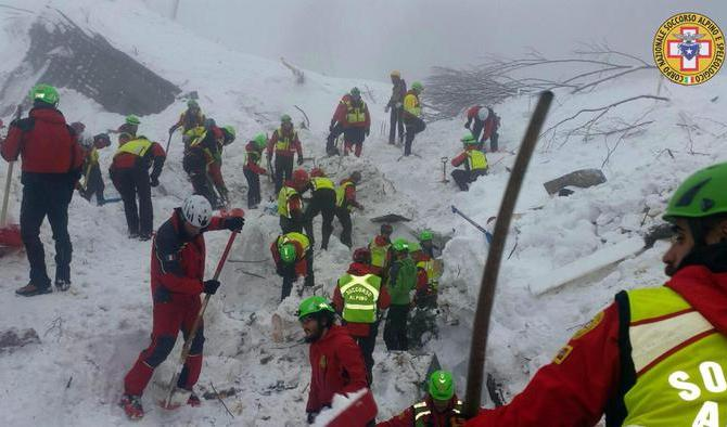 epa05737887 A handout photo made available by the Italian Mountain Rescue Service 'Soccorso Alpino' on 21 January 2017 shows Soccorso Alpino volounters and rescuers at work in Rigopiano, Italy, 21 January 2017. Reportedly at last five bodies have been discovered earlier in the rubble of the luxury Hotel Rigopiano, in the Gran Sasso mountains, 180 kilometers (115 miles) northeast of Rome. Rescue crews are continuing the painstaking search for some 30 people trapped inside a remote Italian mountain resort flattened by a huge avalanche on 18 January 2017 that is believed was triggered by massive earthquakes in the region earlier the same day.  EPA/SOCCORSO ALPINO HANDOUT  HANDOUT EDITORIAL USE ONLY/NO SALES