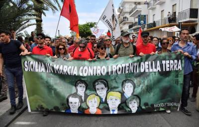 A moment of 'No G7' protest march in Giardini Naxos against the Group of Seven summit in Taormina, 27 May 2017. ANSA/ETTORE FERRARI